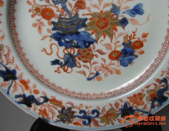 清康熙花卉洞石钒红描金花纹盘